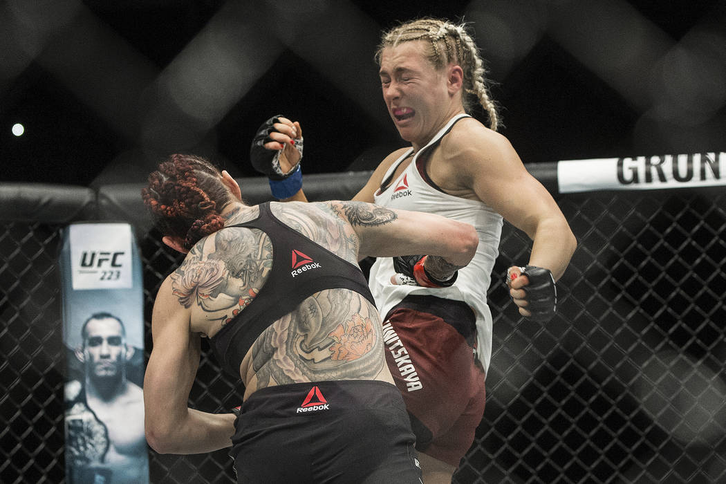 Cris Cyborg, left, connects with a right hook against Yana Kunitskaya during their featherweight championship matchup at UFC 222 at T-Mobile Arena on Saturday, March 3, 2018, in Las Vegas. Cyborg  ...