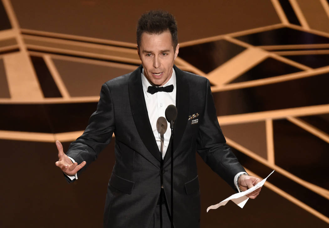 "Sam Rockwell accepts the award for best performance by an actor in a supporting role for ""Three Billboards Outside Ebbing, Missouri"" at the Oscars on Sunday, March 4, 2018, at the Dolby  ..."