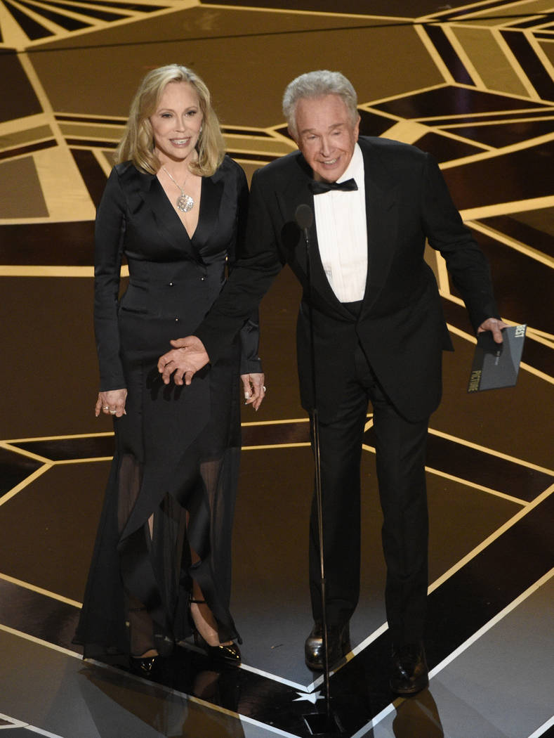 Faye Dunaway, left, and Warren Beatty present the award for best picture at the Oscars on Sunday, March 4, 2018, at the Dolby Theatre in Los Angeles. (Photo by Chris Pizzello/Invision/AP)