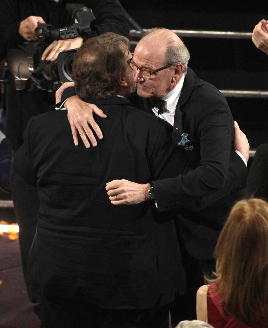 "Guillermo del Toro, left, winner of the award for best director for ""The Shape of Water"" celebrates with Richard Jenkins at the Oscars on Sunday, March 4, 2018, at the Dolby Theatre in L ..."