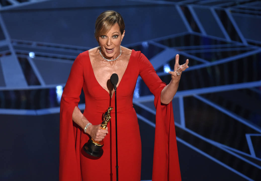 "Allison Janney accepts the award for best performance by an actress in a supporting role for ""I, Tonya"" at the Oscars on Sunday, March 4, 2018, at the Dolby Theatre in Los Angeles. (Phot ..."