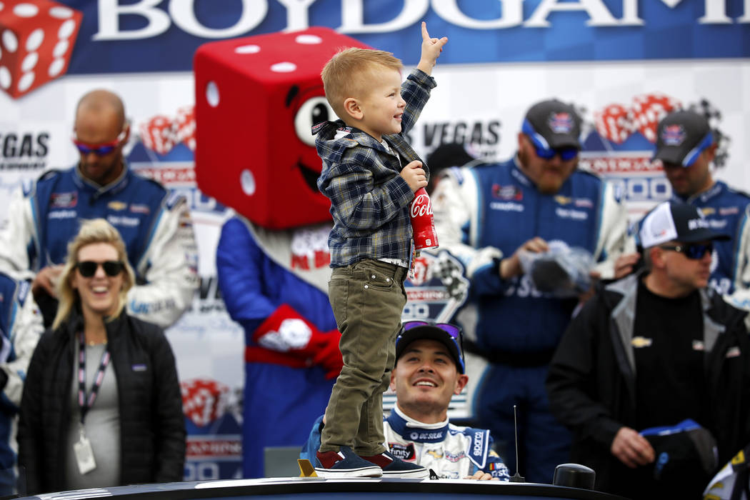 Owen Larson, son of driver Kyle Larson, celebrates his father's victory in the Xfinity Series Boyd Gaming 300 auto race at the Las Vegas Motor Speedway in Las Vegas on Saturday, March 3, 2018. (An ...