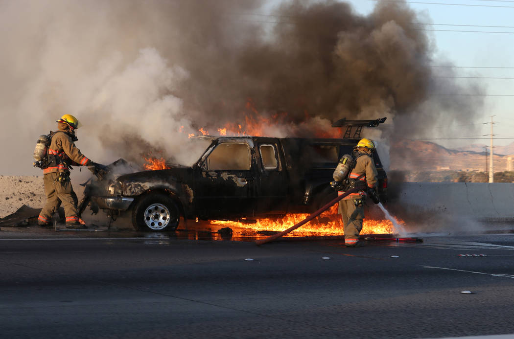 Car fire on northbound 95 near Russell road on Wednesday, February 28, 2018. Michael Quine/Las Vegas Review-Journal @Vegas88s