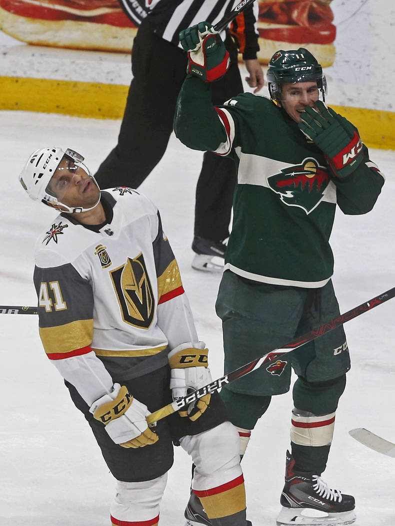 Minnesota Wild's Zach Parise, right, checks out the reaction by Vegas Golden Knights' Pierre-Edouard Bellemare of France after Wild's Jared Spurgeon scored a power-play goal during the second peri ...