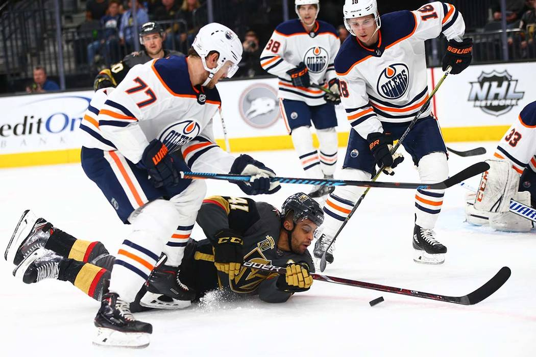 Golden Knights left wing Pierre-Edouard Bellemare (41) falls to the ice while attempting to score as Edmonton Oilers defenseman Oscar Klefbom (77) and center Ryan Strome (18) defend during an NHL  ...
