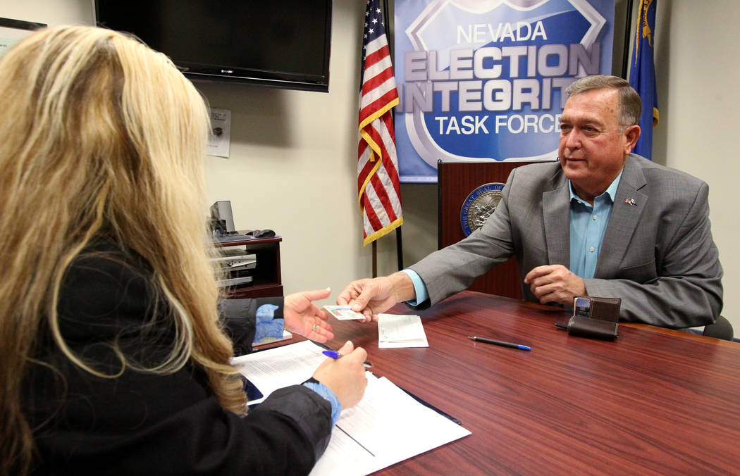 Former Nevada Rep. Cresent Hardy, right, files to run for his old Congressional District 4 seat with Irene Jimenez-Muir at the Secretary of State Las Vegas office Monday, March 5, 2018. Hardy, a R ...