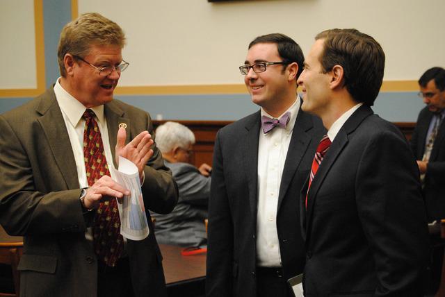 Rep. Mark Amodei, left, speaks with Nevada Attorney General Adam Laxalt, right, before Wednesday's hearing. (Peter Urban/Stephens Washington Bureau)