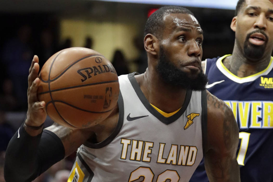 Cleveland Cavaliers' LeBron James (23) drives past Denver Nuggets' Wilson Chandler (21) in the first half of an NBA basketball game, Saturday, March 3, 2018, in Cleveland. (AP Photo/Tony Dejak)