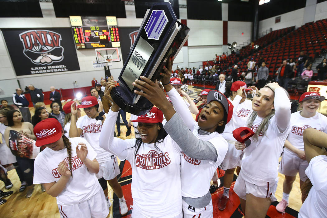 UNLV Lady Rebels players celebrate their regular season Mountain West championship win after defeating Utah State at the Cox Pavilion in Las Vegas on Friday, March 2, 2018. Chase Stevens Las Vegas ...