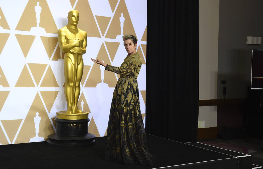 """Frances McDormand, winner of the award for best performance by an actress in a leading role for """"Three Billboards Outside Ebbing, Missouri"""", poses in the press room at the Oscars on Sund ..."""