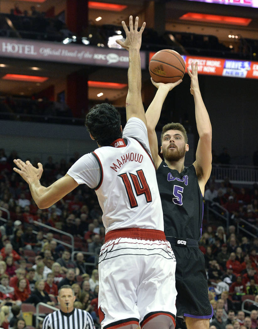 Grand Canyon forward Matt Jackson (5) shoots over the defense of Louisville forward Anas Mahmoud (14) during the first half of an NCAA college basketball game, Saturday, Dec. 23, 2017, in Louisvil ...