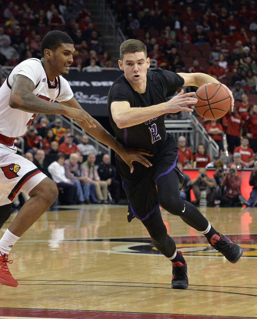 Grand Canyon forward Roberts Blumbergs (12) attempts to drive past the defense of Louisville forward Malik Williams (5) during the first half of an NCAA college basketball game, Saturday, Dec. 23, ...