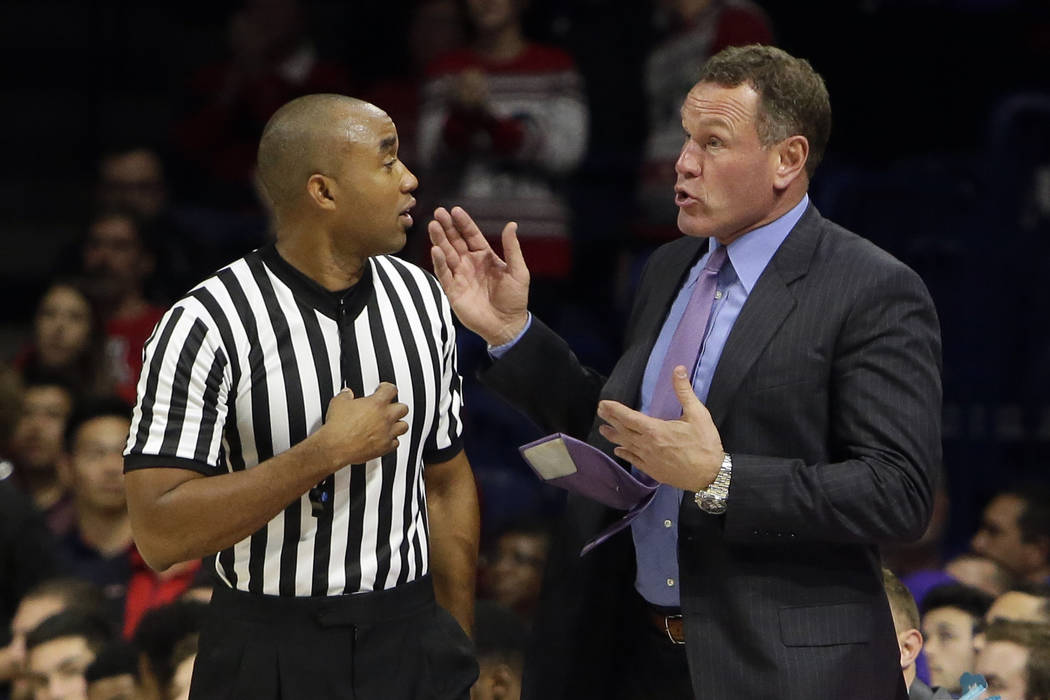 Grand Canyon head coach Dan Majerle talks to an NCAA official during the second half of an NCAA college basketball game against Arizona, Wednesday, Dec. 14, 2016, in Tucson, Ariz. (AP Photo/Rick S ...