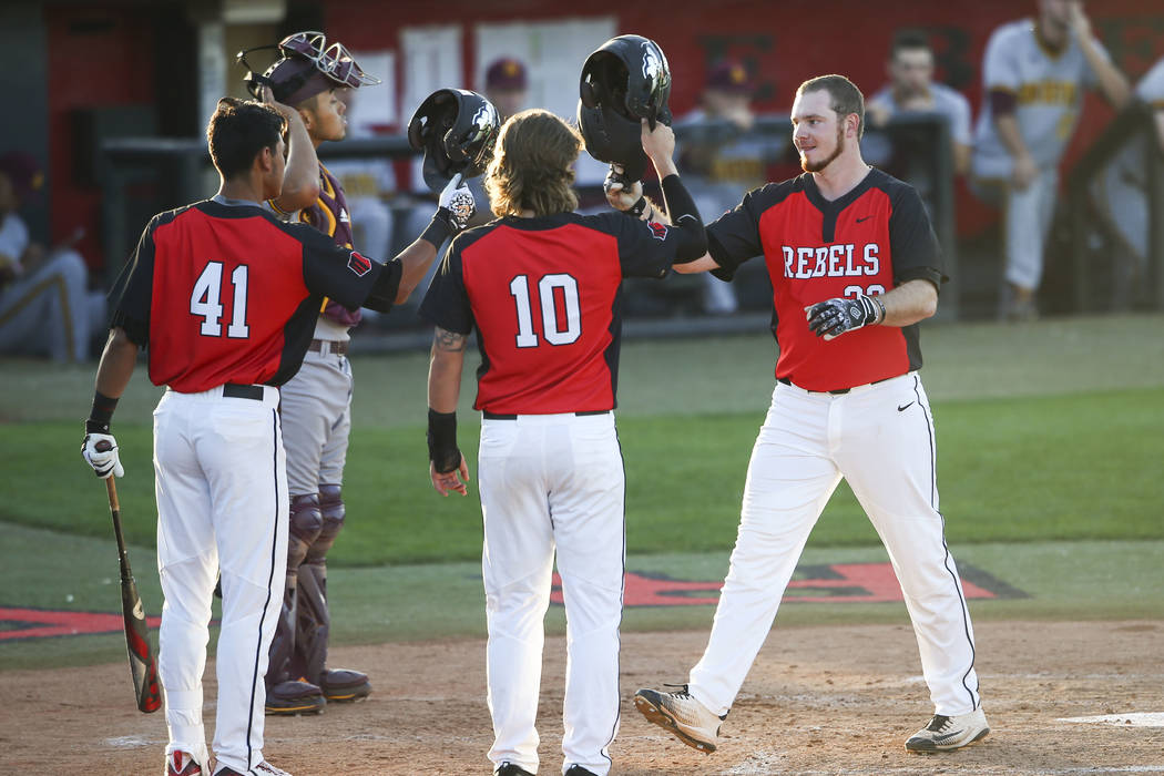 UNLV's Corey Pool (32) celebrates after his home run against Arizona State in the second inning during a baseball game at Wilson Stadium in Las Vegas on Tuesday, April 18, 2017. Pool followed up w ...