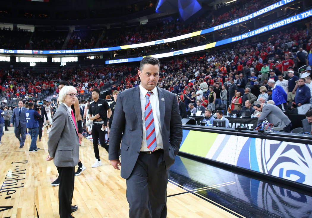 Arizona Wildcats head coach Sean Miller leaves the court after an NCAA college basketball game against Colorado Buffaloes in the quarter final of the Pac-12 tournament on Thursday, March 8, 2018,  ...
