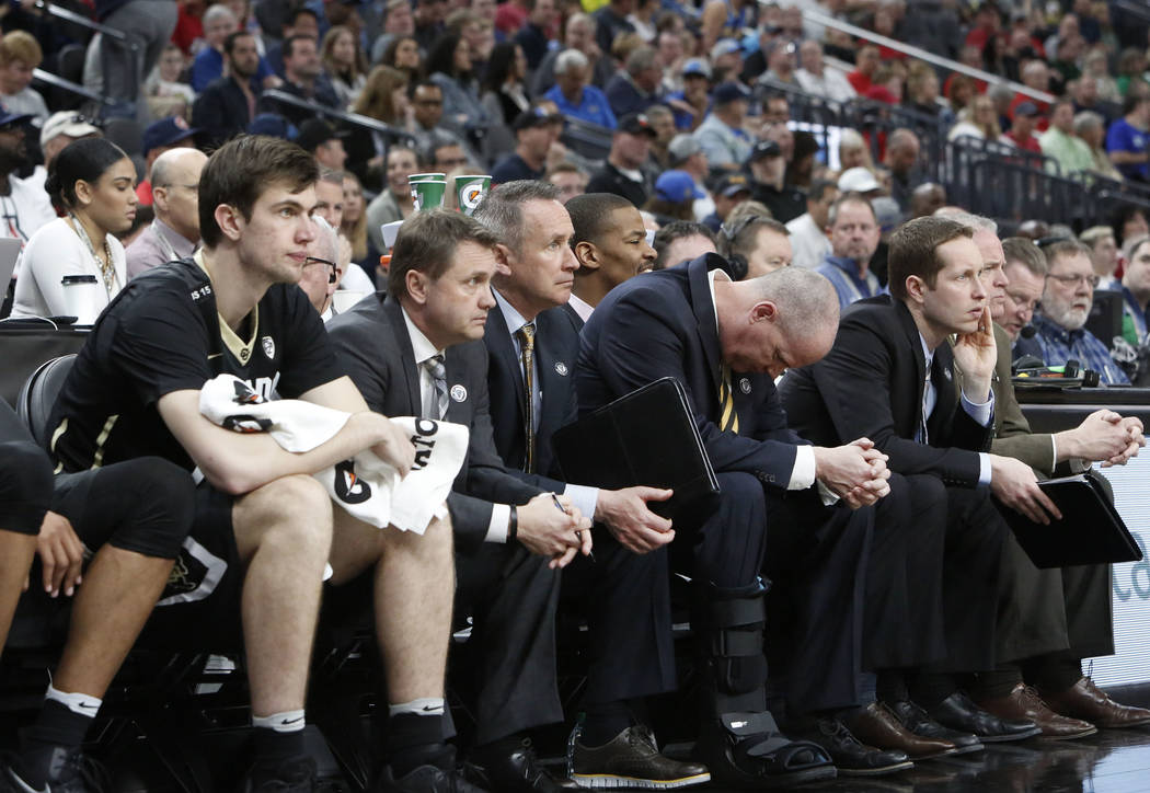 Colorado Buffaloes' head coach Tad Boyle, second right, bows his head as he watches the final moment of an NCAA college basketball game against Arizona Wildcats in the quarter final of the Pac-12  ...