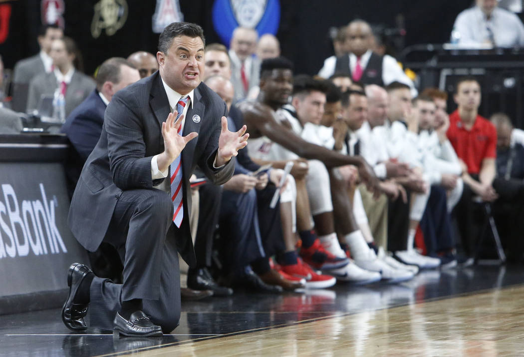 Arizona Wildcats Sean Miller directs his players during an NCAA college basketball game against Colorado Buffaloes in the quarter final of the Pac-12 tournament on Thursday, March 8, 2018, in Las  ...
