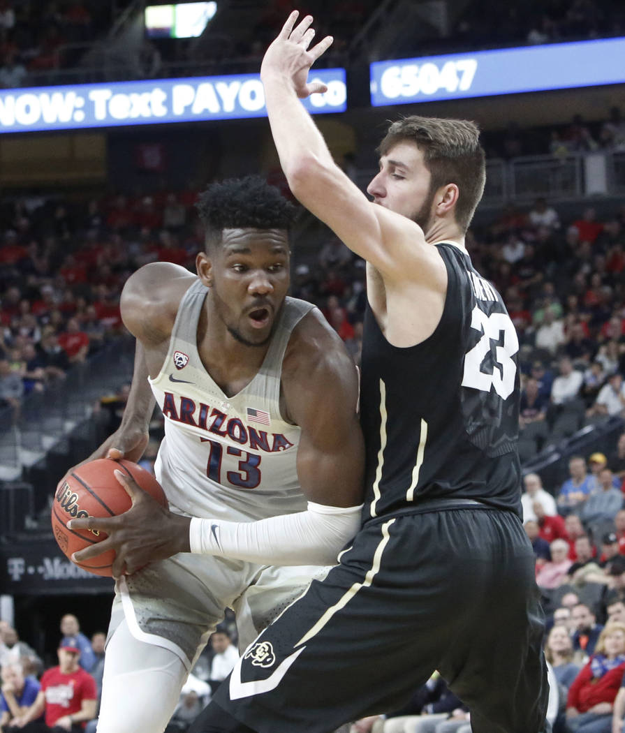 Colorado Buffaloes' Lucas Siewert (23) defends Arizona Wildcats' Deandre Ayton (13) during an NCAA college basketball game in the quarter final of the Pac-12 tournament on Thursday, March 8, 2018, ...