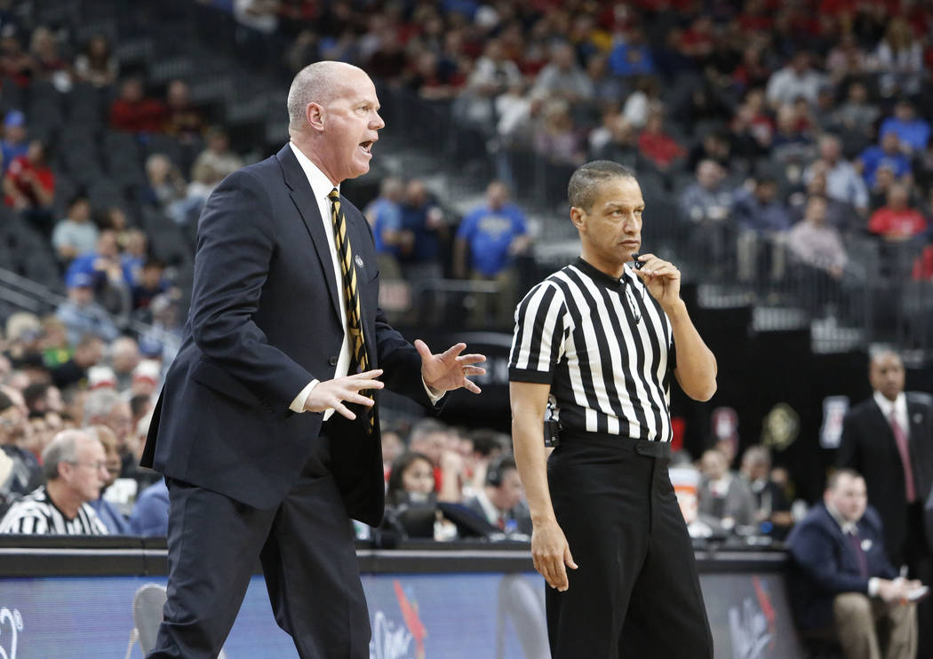 Colorado Buffaloes' head coach Tad Boyle argues with an official during an NCAA college basketball game in the quarter final of the Pac-12 tournament on Thursday, March 8, 2018, in Las Vegas. Ariz ...