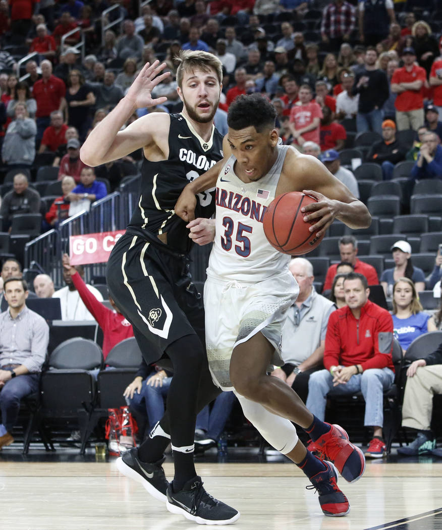 Arizona Wildcats' Allonzo Trier (35) drives past Colorado Buffaloes' Lucas Siewert (23) during an NCAA college basketball game in the quarter final of the Pac-12 tournament on Thursday, March 8, 2 ...