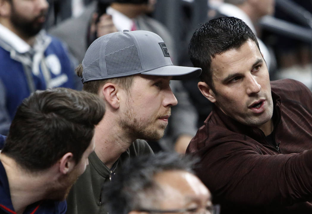 Eagles quarterback Nick Foles, center, attends an NCAA college basketball game between Colorado Buffaloes and Arizona Wildcats in the quarter final of the Pac-12 tournament on Thursday, March 8, 2 ...
