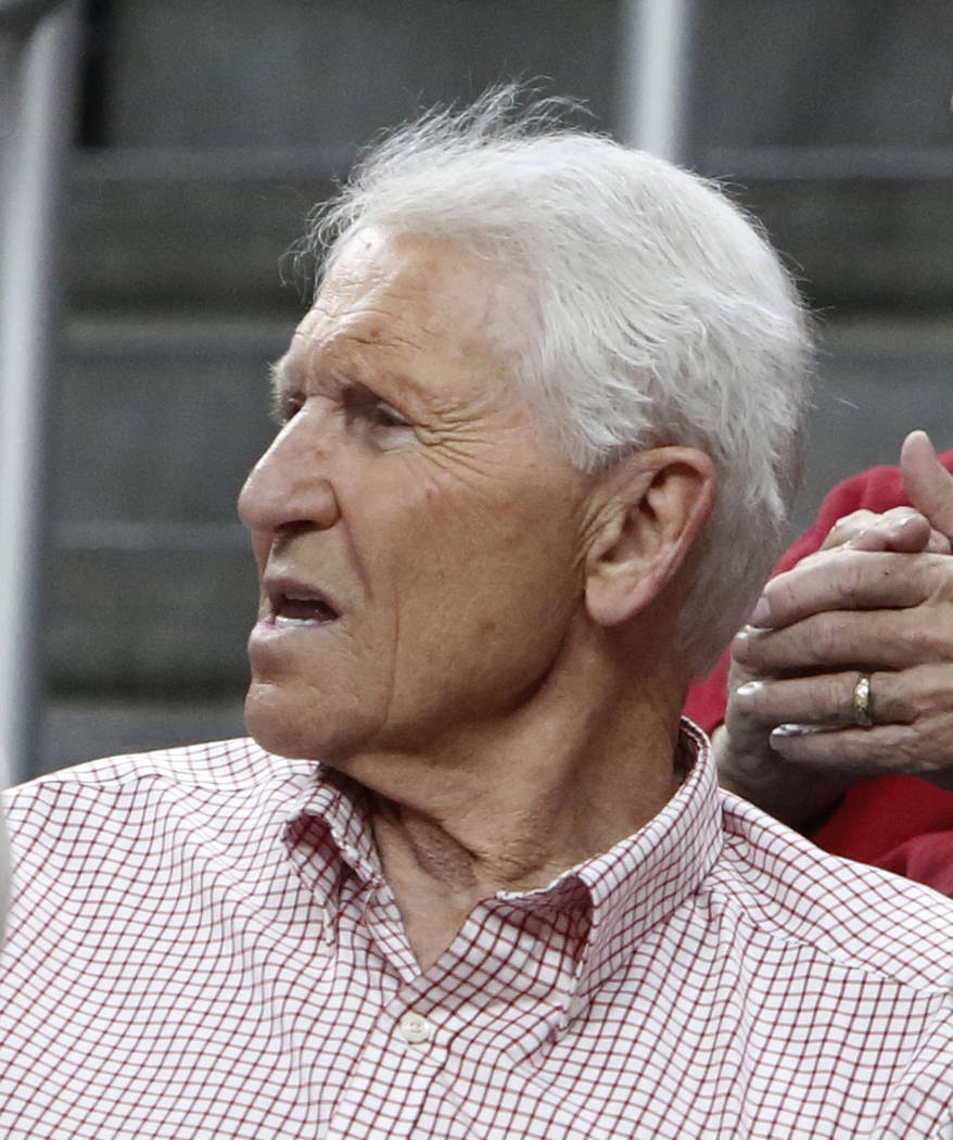 Lute Olson, former head coach of the University of Arizona's men's team, attends an NCAA college basketball game between Colorado Buffaloes and Arizona Wildcats in the quarter final of the Pac-12  ...