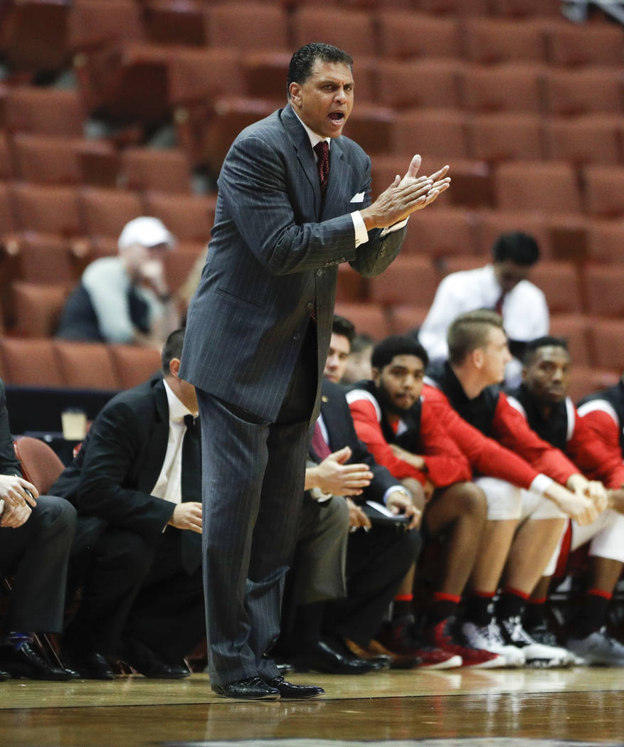 Cal State Northridge head coach Reggie Theus watches action during the first half of an NCAA college basketball game against Cal State Fullerton at the Big West men's tournament on Thursday, March ...