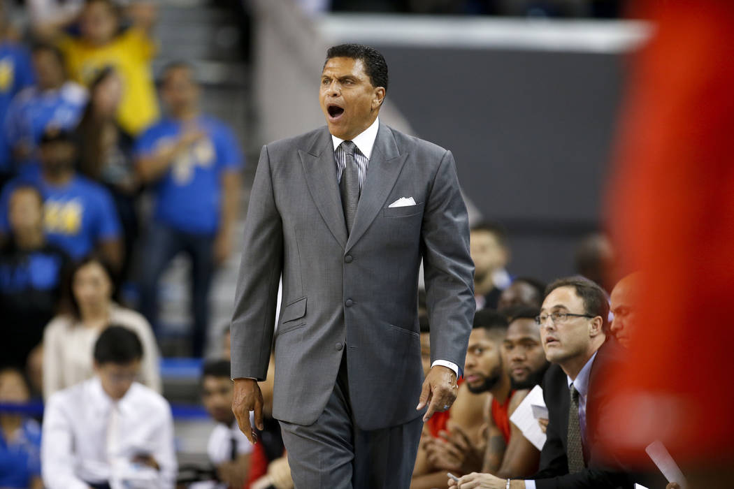Cal State Northridge head coach Reggie Theus directs his team against UCLA during the first half of an NCAA college basketball game Sunday, Nov. 13, 2016, in Los Angeles. (AP Photo/Danny Moloshok)