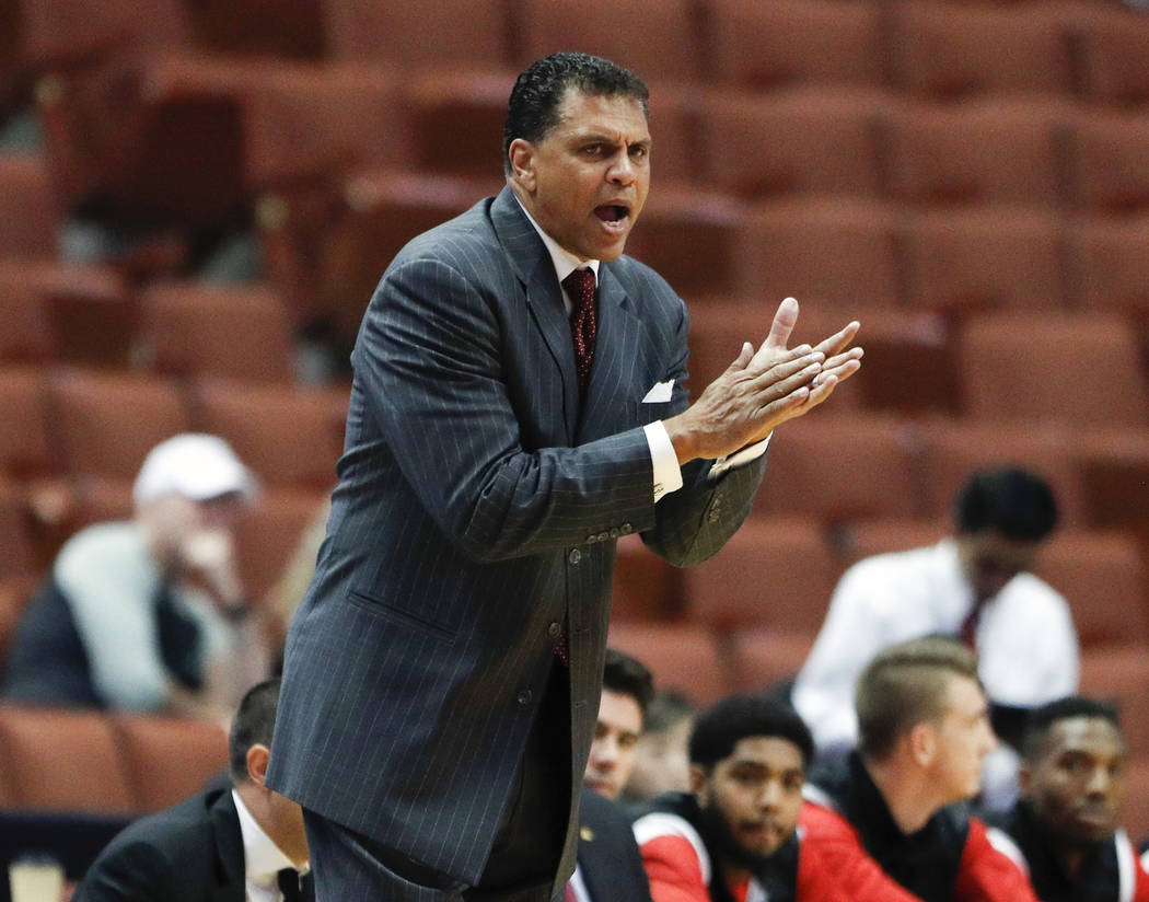 FILE - In this March 9, 2017, file photo, Cal State Northridge head coach Reggie Theus gestures during the first half of an NCAA college basketball game against Cal State Fullerton,  at the Big We ...