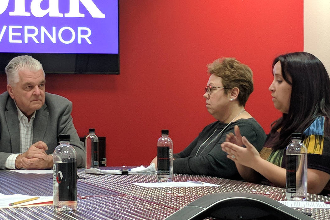 Democratic Nevada governor candidate and Clark County Commission chairman Steve Sisolak, left, listens as Eldorado High School teacher Jennifer Manning, far right, discusses educaiton policy at a  ...