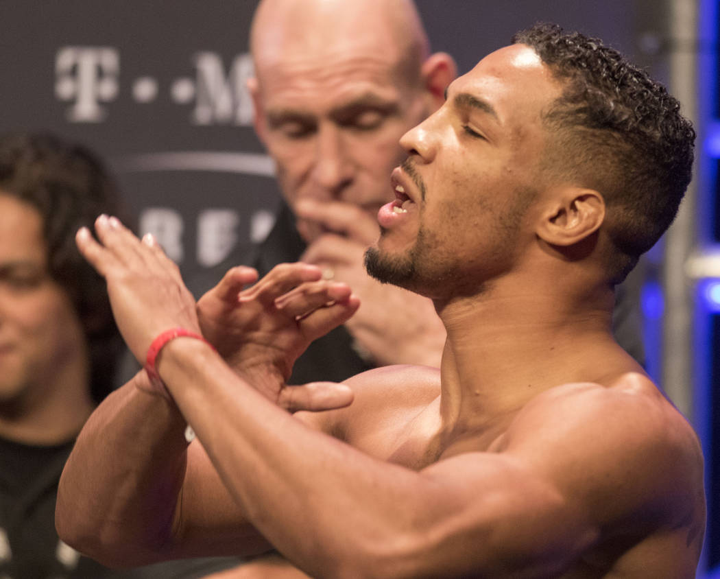 UFC lightweight contender Kevin Lee gestures toward Tony Ferguson, not pictured, at the T-Mobile Arena during the UFC 216 ceremonial weigh-ins in Las Vegas, Friday, Oct. 6, 2017. Heidi Fang Las Ve ...