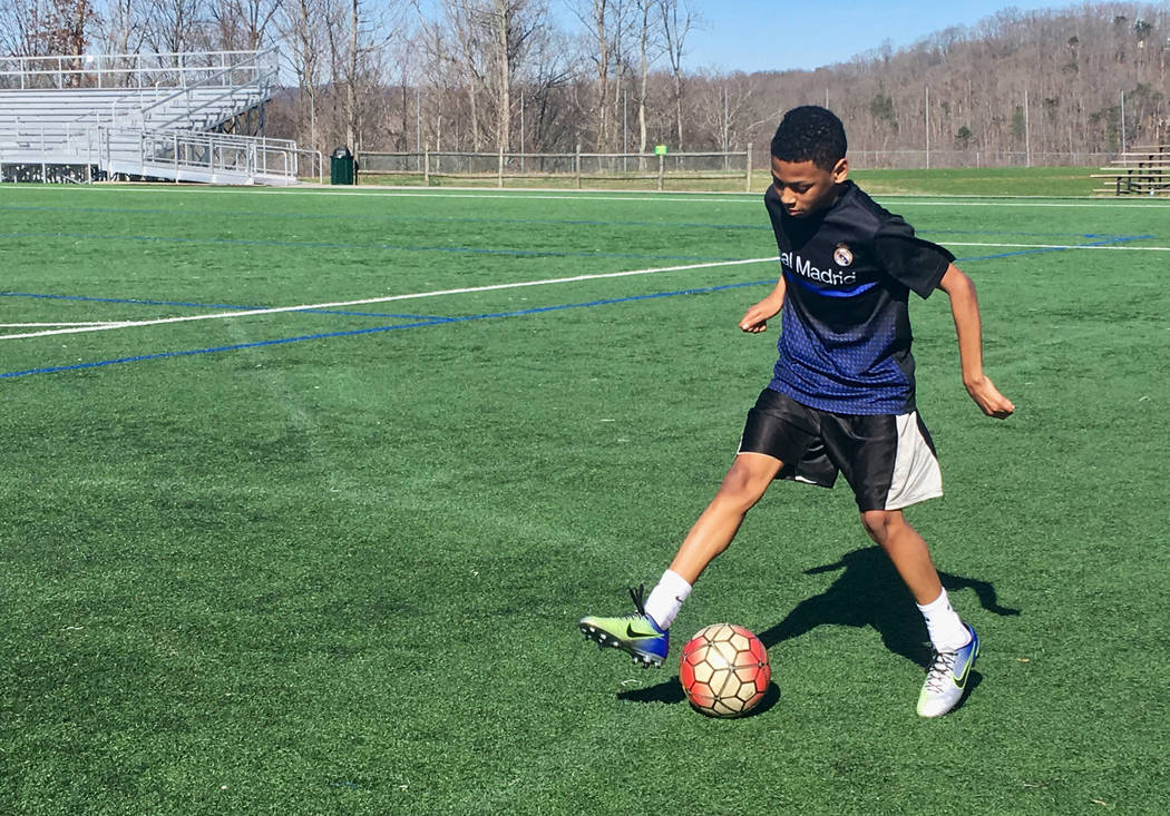 "In this Feb. 27, 2018, photo, C.J. Napper works on his soccer moves in South Charleston, W.Va. Napper said he was in no rush to get back to classes. ""I don't like school. It's not fun,"" Napper sai ..."