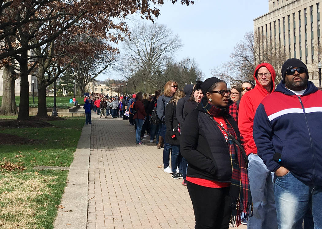 Striking West Virginia teachers line up Monday, March 5, 2018, to enter the state Capitol in Charleston, W.Va. Teachers are waiting for state lawmakers to agree on a pay raise, and state House and ...