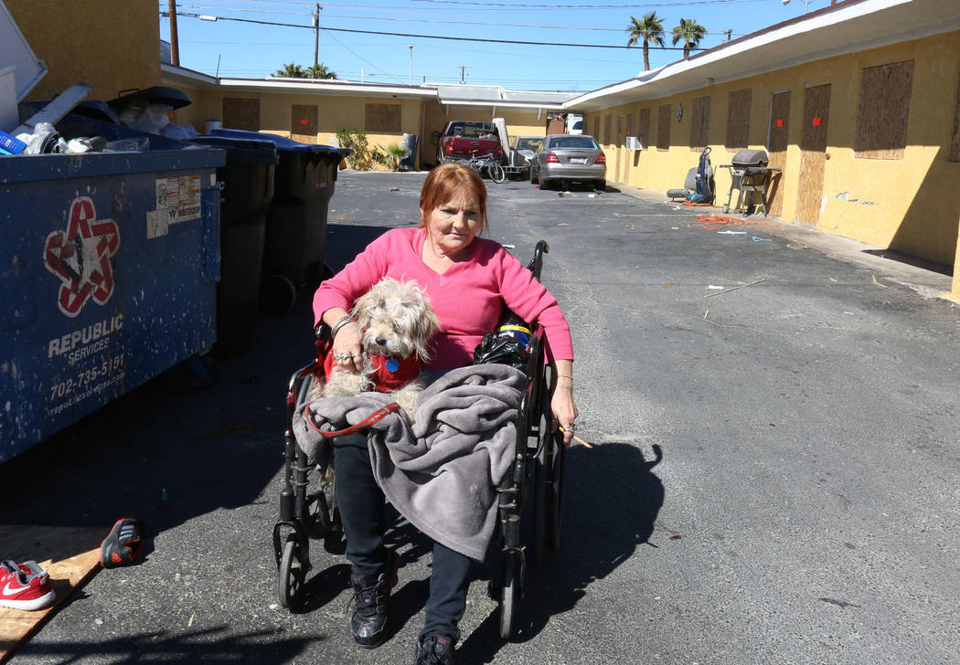 Paloma Castrejon, resident at Las Haciendas Apartments at 2504 Las Vegas Blvd North, sits with her dog Princess outside her boarded up apartment on Monday, March 5, 2018, in Las Vegas. Twenty five ...