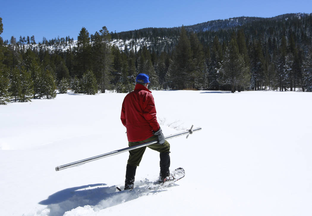 Frank Gehrke, chief of the California Cooperative Snow Surveys Program for the Department of Water Resources, heads out to snow covered meadow to conduct a supplemental snow survey Monday, March 5 ...