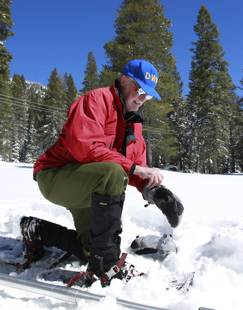 Frank Gehrke, chief of the California Cooperative Snow Surveys Program for the Department of Water Resources, puts on his gloves before conducting a supplemental snow survey Monday, March 5, 2018, ...