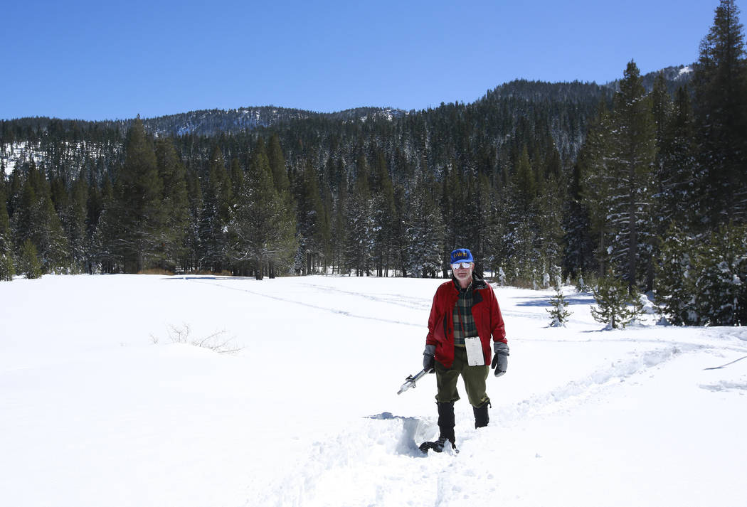 Frank Gehrke, chief of the California Cooperative Snow Surveys Program for the Department of Water Resources, leaves a snow covered meadow after conducting a supplemental snow survey Monday, March ...
