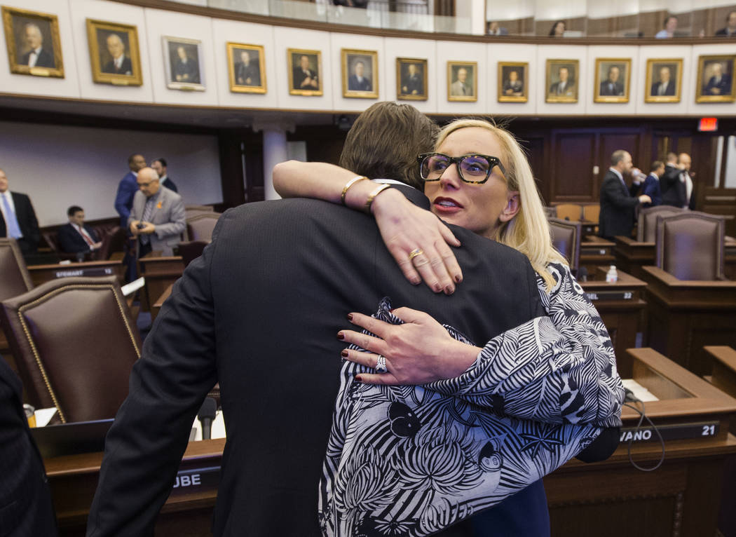 Florida Sen. Lauren Book, right, embraces Sen. Bill Galvano after Galvano's bill, the Marjory Stoneman Douglas High School Student Safety Act, passed 20-18 at the Florida Capitol in Tallahassee, F ...