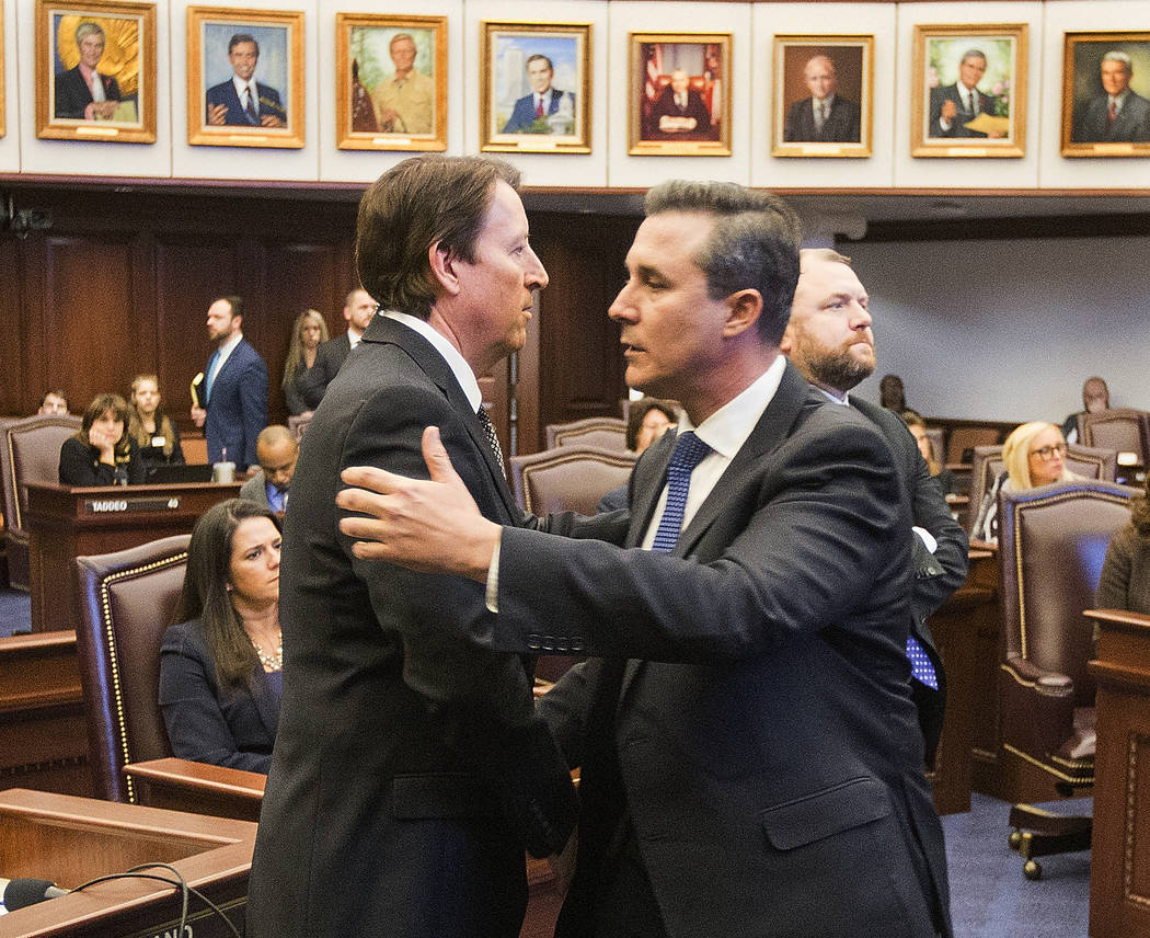 Florida Sen. Rene Garcia, right, embraces Sen. Bill Galvano after Galvano's bill, the Marjory Stoneman Douglas High School Student Safety Act, passed 20-18 at the Florida Capitol in Tallahassee, F ...