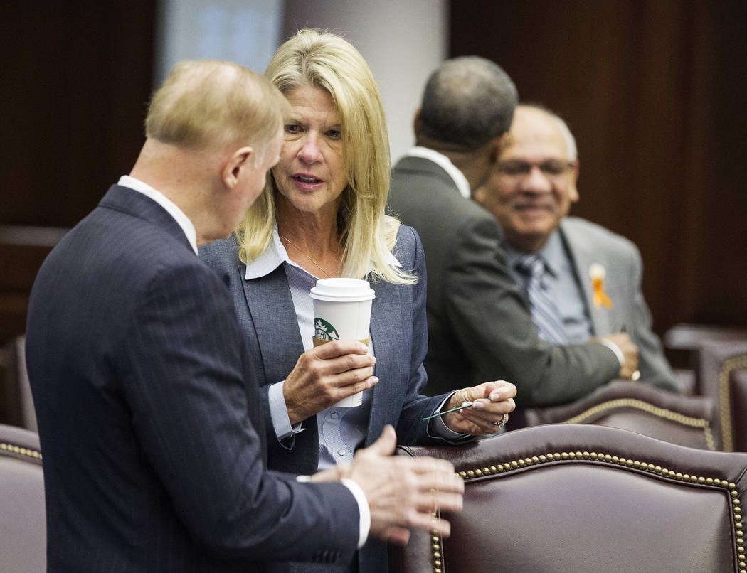 Florida Sens. David Simmons, left, talks with Debbie Mayfield in the Senate Chambers at the Florida Capital before the start of a legislature session in Tallahassee, Fla., Monday, March 5, 2018. ( ...