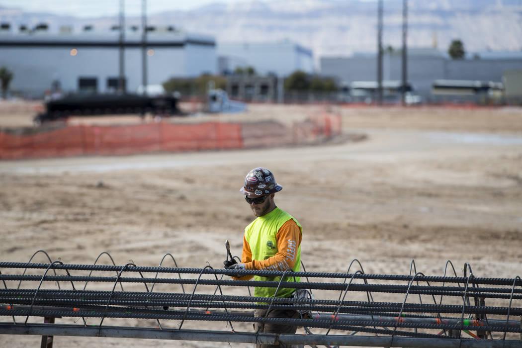 A worker handles steel rods at the future Raiders stadium site in Las Vegas, Tuesday, March 6, 2018. (Erik Verduzco/Las Vegas Review-Journal) @Erik_Verduzco