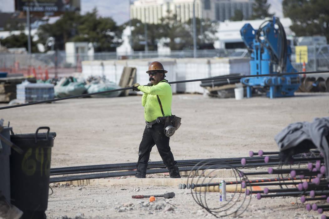 A worker handles steel rod at the future Raiders stadium site in Las Vegas, Tuesday, March 6, 2018. (Erik Verduzco/Las Vegas Review-Journal) @Erik_Verduzco