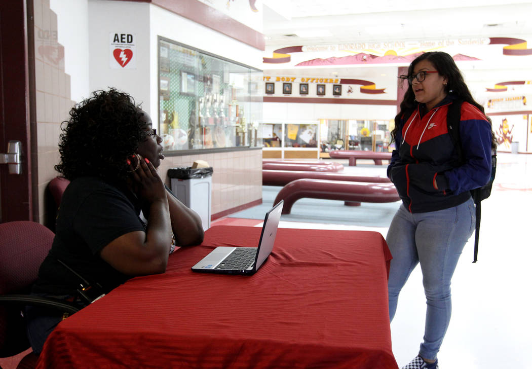 Eldorado High School Campus Security Monitor Shameka Green, left, visits with sophomore Alondra Martinez at the entrance to the school Friday, March 9, 2018. K.M. Cannon Las Vegas Review-Journal @ ...