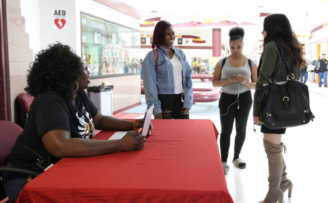 Eldorado High School Campus Security Monitor Shameka Green, left, visits with, from second from left, Ferron Bobbitt, Vaida Franklin and Kimberly Zamora at the entrance to the school Friday, March ...