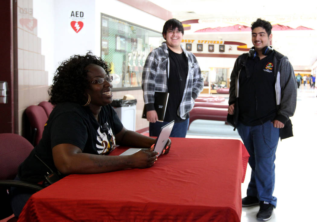 Eldorado High School Campus Security Monitor Shameka Green, left, visits with Ezequiel Pineda, second from left, and Elias Kosho at the entrance to the school Friday, March 9, 2018. K.M. Cannon La ...