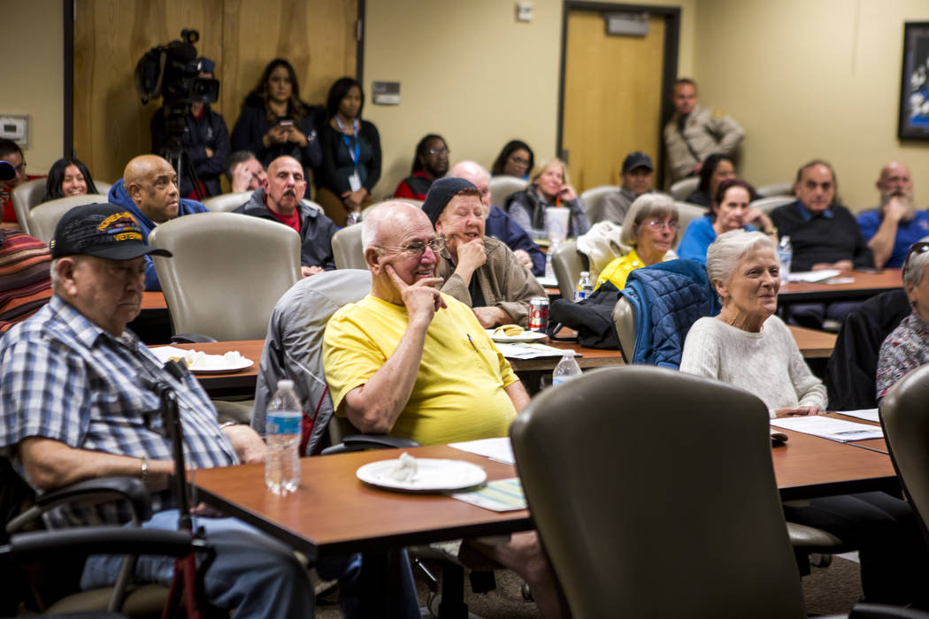 """Community members attend a meeting about school safety measures and policing in the Clark County School District during a """"1st Tuesday"""" event at Metro's Northeast Area Command on Tuesday ..."""