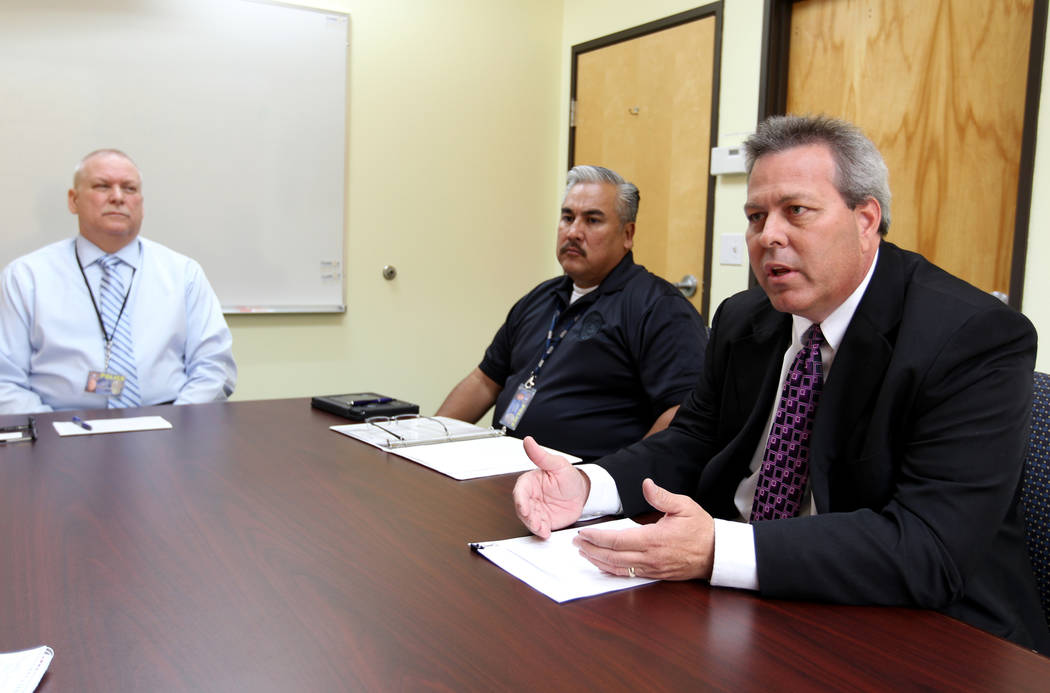 Clark County School District Police officials, from left, Chief James Ketsaa, Lt. Roberto Morales and Emergency Management Director Michael Wilson talk about school safety during an interview at p ...