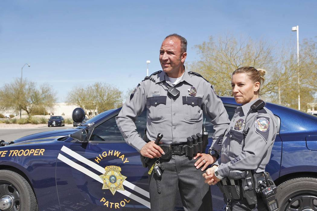 NHP Trooper Joseph DellaBella, left, and his wife and fellow NHP Trooper Trisa DellaBella talk to reporters at the NHP Southern Command in Las Vegas, Tuesday, March 6, 2018. Early Saturday morning ...