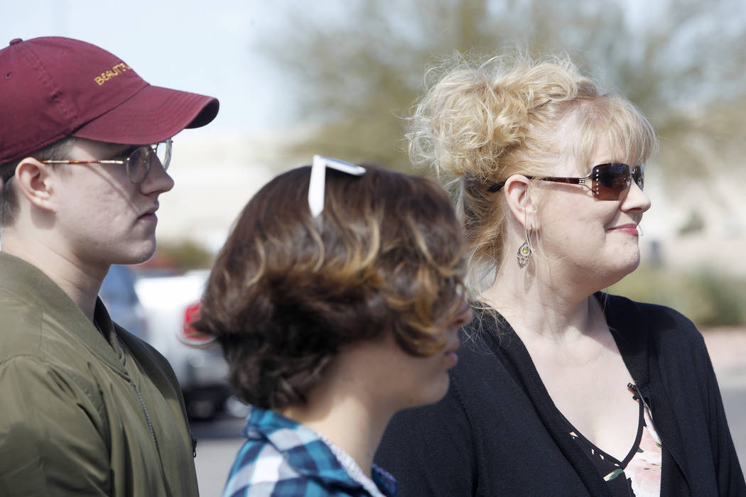 Noah Isbell, 19, from left, his girlfriend, Cinthea Daly, 18, and his mom, Solinea Stark, talk to reporters on Tuesday, March 6, 2018. Stark and her children were saved early Saturday morning when ...