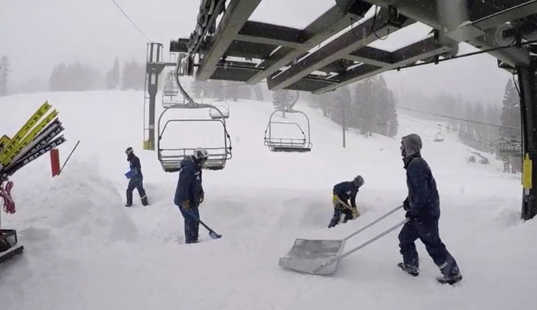 In this image provided by the Kirkwood Mountain Resort, fresh snow is cleared below a ski lift Friday, March 2, 2018, in Kirkwood, Calif. A blizzard warning was in effect for parts of the Sierra N ...